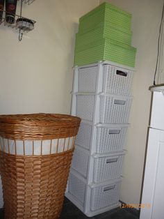 Idea for small bathroom space. Storage boxes for family toiletries.