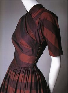 Claire McCardell: lots of McCardellisms here! The surplice top, the wide waist band, the brass hook and eye, the beautiful bias draping and the use of stripes/plaids to greatest effect.