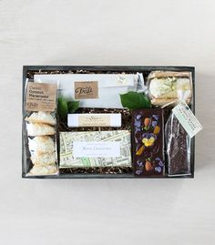 Dessert in a box—this beautifully-curated crate is an ode to sugar in all forms: 'Sweets and Treats' by Winston Flowers.