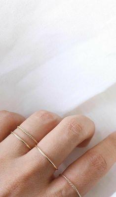right hand. ring finger. middle finger. index finger. gold.