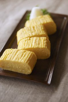 """Tamagoyaki. Tamago is the Japanese word for egg. Yaki means """"grilled."""" In sushi, it refers to a sweetened omelet made in a rectangular pan, cut into small rectangles for sushi or sashimi. When a slice of dried nori (seaweed) is wrapped around the slice of omelet, it is known as nori-tama. Ingredients 4 eggs 1/4 tsp salt 1/4 tsp soy sauce 1 Tbsp Mirin (or 1/4 tsp sugar) 1 tsp oil"""
