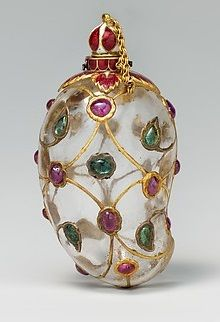 Mango-Shaped Flask, mid-17th century, India, composed of rock crystal and set with gold, enamel, rubies, and emeralds. In spite of its modest size, this flask in the shape of a mango, adorned with gold, gems, and enamelling. Likely to have been created during the reign of Shah Jahan, the emperor who built the famous Taj Mahal, the flask expresses the Mughal love of natural forms and precious materials.