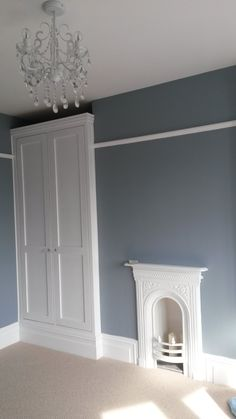Note: Bespoke fitted wardrobes and cast iron fire place for bedroom Walls painted in steel symphony Alcove Wardrobe, Bedroom Alcove, Built In Wardrobe, Home Bedroom, Bedrooms, Bedroom Wardrobes Built In, Bedroom Storage, Master Bedroom, Edwardian House