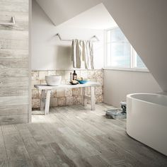 Madeira combines the strength of porcelain stoneware with the elegance and warmth of the finest wood. #Iris #MadeiraGrigio #floor #wood #design