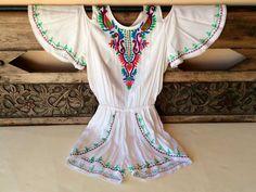 Comprar mono blanco online. Tu tienda online de ropa blanca. Diseñadores y  fabricantes de ropa ibicenca online. 1f0d2318b44a