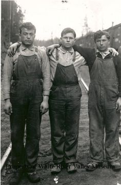 Three railroad section workers circa 1915.