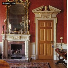 The dining room at Henbury Hall, with a chimneypiece and doorcase carved in York by Dick Reid. The house was built in 1984-86, the result of a collaboration between the patron Sebastian de Ferranti, the architect Julian Bicknell and the artist Felix Kelly, all Palladio enthusiasts.