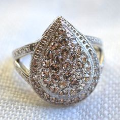 HPDiamond & White Swarovski Crystals Pear Ring Size 5 & 6 on hold until 12/11/15. More sizes coming soon! Comment with what size you want!Available in sizes 5 & 6. .01 ct TW. Pear shaped ring. Brand new. Absolutely stunning ring in person! Comes with a red velvet drawstring bag and is also in a small ziploc protective bag. Host Pick Pretty, Flirty & Girly Party 11/23/15 Please let me know which size you would like to purchase so I can make you a separate listing. Price will not be lowered…