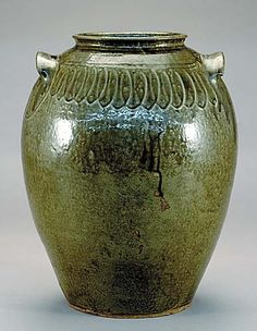 Edgefield District stoneware storage jar, Thomas Chandler circa 1850 ovoid form with loop decoration on shoulder and flanked by ear-form handles; impressed mark: Chandler Maker.