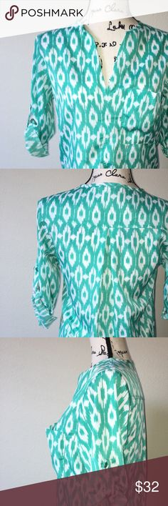 Collective concepts XS mint green top Good used condition collective concepts top in size XS. Mint green pattern with cropped sleeves and front pocket. Flexible/loose fit. Collective Concepts Tops Blouses