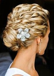 Intricate wedding hair for the bride.  Silver flower is a nice touch!
