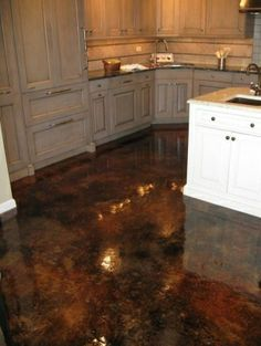 Wood kitchen cabinets & stained concrete floors | Acid Stained Concrete With High Gloss Flooring