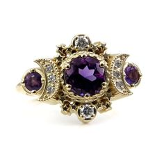 Amethyst and Diamond Cosmos Engagement Ring - Moon Goddess Fine Jewelry This moon and star ring is a ode to the Triple Moon Goddess symbol of the full moon flanked by crescent moons. The full moon is a stunning 6mm faceted amethyst that weighs approximately .90 carats, nest to