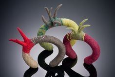 Spiked Cuffs, 2012, $225 Hand felted wool cuffs, embroidered over copper wire armature. Wire is adjustable to fit. Wine and olive cuff size: 6 inch wrist size minimum. Taupe, grey, red cuff- SOLD