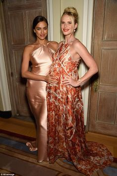 Firm friends: Anne V had her bump caressed by fellow model Irina Shayk at theBloomberg an...