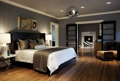 [Bedroom] : The Contemporary Bedroom Decoration With Indoor Flooring In Laminating Of Wood Also One Nig Size Bed In Pillows In Grey Colour Plus One Big Pendant Light In Chrome Plus Three Ceilling Light