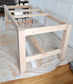 This large farmhouse table seats 8+ and adds great rustic charm to your dining room. See more photos and project details at http://LoveGrowsWild.com