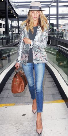 Rosie Huntington-Whiteley  En route to Nice, France for the Cannes Film Festival.  Maison Michel hat  Mary Katranzou blazer   AG Adriano Goldschmied The Legging Ankle in 17 Years Western Studded  Viktor & Rolf Bombette Bag in Nuts from the F/W 13 collection.