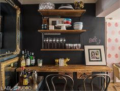 As much as we love bar carts, unique home bar ideas that don't involve a cart will make you stand out from the rest of the boozy crowd. You don't even have to live in a big place either — it's easy to create a bar shelf or bar table with a little rearranging.