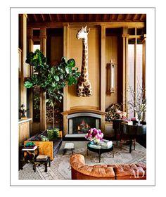 ken fulk living room masculine luxe giraffe head
