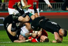 Williams ends up head over heels after being tackles by New Zealand's Beauden Barrett and . British And Irish Lions, Rugby Players, New Zealand, Tours, Heels, Heel, High Heel, Stiletto Heels, High Heels