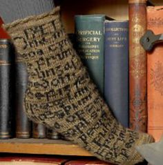 Socks with the opening text of Beowulf!  Hwaet!  These are so awesome, but I can't find the pattern to buy anywhere.