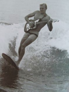 You may be cool. But you will never be surfing while singing at a Fender guitar cool.