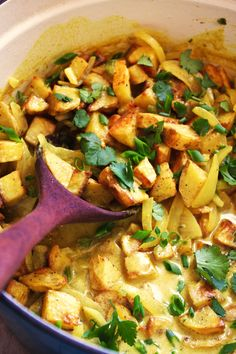 Crispy Potato Curry - A simple and delicious dish! Crispy potatoes and a creamy sauce made with coconut milk, onions, garlic, jalapeños, and homemade curry powder all mix together to form a flavorful pot of comforting goodness!! Gluten free - vegan. TheGarlicDiaries.com