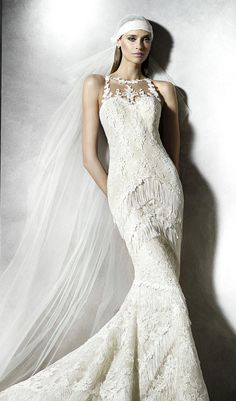 Try this mermaid wedding dress, beige tulle with lace appliques, thread embroidery and fringes. Bodice with halter neck and sheer under-bodice with rebrode lace appliques. Skirt with fringe appliques. Sheer back with rebrode lace appliques. From Pronovias. Available at Schaffer's in Des Moines, Iowa. Wedding Dress Info: PRONOVIAS – STYLE PLADIA.