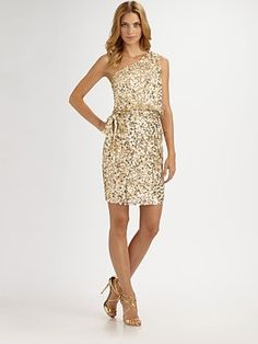 sequined dress. Why I'm looking at dresses that I can't fit into right now....I have no idea....