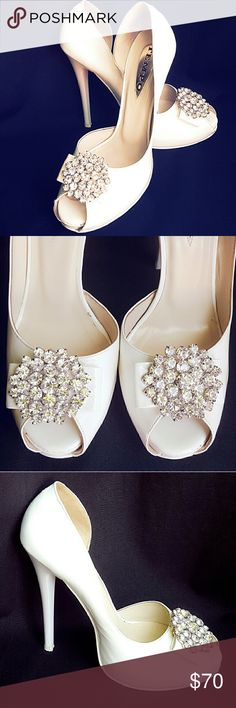 Gorgeous white shoes Beautiful patent PU and absolutely stunning crystal detail centerpiece. All eyes on you and this is the right shoe for center of attention. Bought in Europe, Only worn once, for couple hours on a wedding. Size is 37 European, fits 6 1/2 - 7. Tempo Shoes Heels