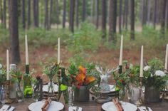 winter woodland tablescape with tall, skinny candles