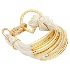 Multi-strand cotton cord bracelet with gold-finished hardware and a lobster clasp.  Product: BraceletConstruction Ma...