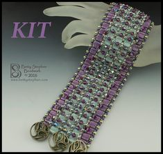 This textured bracelet has such a fabulous drape- you will just love the feel of it! It uses several of the newer shaped beads, including the Groovy Tiles and Trinity beads. The Swarovski bicone crystals on the top layer lend a little bling as well as a nice weight. The bracelet