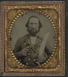 Soldier in Confederate uniform with large Bowie knife and revolver 1861-65