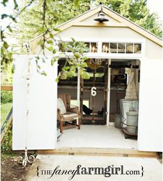 Chicken coop. I really like the fancy farm girl style. That's one spoiled chick. Lol!