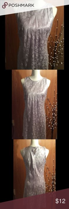 DBY white satin like dress size 9. - 10 White satin feel dress with flowers imprinted in the material.  Sleeveless.  One button on the back.  Perfect for wearing during the holidays, to a party, or a special date.  Brand:  DBY L.T. D.  Materials:  57% rayon and 43% polyester. Size 9 - 10.   Measurements   Length:  33 inches  Bust:  17 1/2 inches side to side  Waist:  16 1/2 inches side to side  Listing:  # 109 DBY Dresses