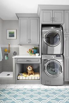 Don't Forget Fido - 10 Laundry Room Ideas We're Obsessed With - Southernliving. Here, a stacking washer and dryer make room for a dog-washing station—no more struggling over the tub. A dog bed nook makes for perfect post-bath naps.  See Pin