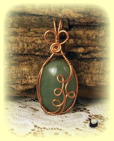 Copper Pendant Wire Sculpted with Green Adventurine Cabochon Stone  - Item PCGa008. $32.00, via Etsy.