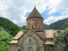 Dadivank Monastery is the largest monastic complex in the Republic of Nagorno Karabakh. It was founded by St Dadi, a disciple of St Thaddeus who spread Christianity through eastern Armenia in the century AD. Reformed Theology, Armor Of God, 1st Century, The Republic, Barcelona Cathedral, Christianity, War, Armenia, House Styles