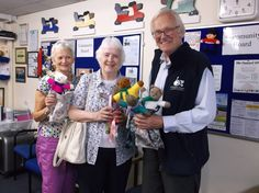 Maureen Smith & Margaret Eyres from Laverstock W.I handing over their knitted teddy bears to Hugh Abel at Shopmobility ready to go to the Trussell Trust Project 'Angel Bears'. Summer 2013