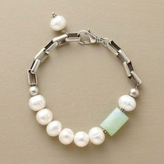 """Inspired by the cloud-strewn blue sky of a perfect spring day, our bracelet pairs freshwater cultured pearls with a faceted barrel bead of chalcedony. Square sterling links with a matte finish provide the silver lining. Lobster clasp. Size and color of stone will vary. Made in the USA. 7-1/4""""L."""