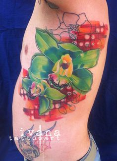 A tattoo of some bright green orchids by artist Ivana Belakova.   Intenze ink