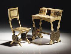 Carlo Bugatti   (1855-1940) - Bureau de dame et sa chaise vers 1902 -   En érable, entièrement gainé de parchemin, à décor peint de libellules et de coquelicots, incrustations de disques de cuivre à décor repoussé - Le bureau signé Bugatti à l'intérieur de la porte droite, la chaise signée Bugatti au revers de l'assise, sur une traverse (2) Le bureau H: 92 cm.(36¼ in.)