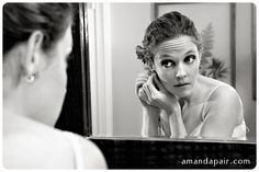 i like the playing with mirrors as frames.  I like the crispness of the photo and the balance of greys, whites, and blacks
