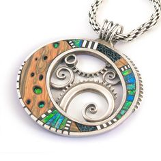 Large Silver and Polymer Pendant with Iridescent inlay and Faux wood. $445.00, via Etsy. (Liz Hall)