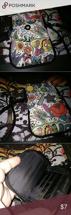 """Fun Patterned Colorful Wallet Very cute wallet Has a super pretty fun pattern about it Has card slots in the inside and can fit devices up to 5.5""""  *BUNDLE WITH OTHER ITEMS TO SAVE ON SHIPPING & 15% OFF BUNDLE DISCOUNT* Bags Wallets"""