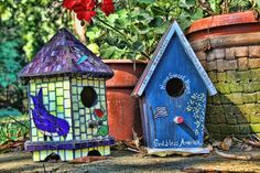 birdhouses decorated with tiles