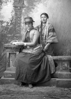 Shooting Star, Dakota, and her sister, sister in white woman's clothing, full length :: Western History
