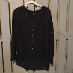 H&M black polka dot blouse Black blouse with small white polka dots. Hangs a little longer in the back. Sleeves can be rolled up. H&M Tops Button Down Shirts